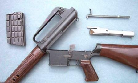 The original AR-10, partially field-stripped. The similarity to the latter AR-15/ M16 rifles is obvious