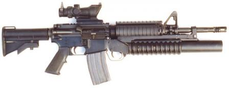 Colt M4 carbine, current issue model with Trijicon ACOG telescope sight installed over the integral Picatinny rail and M203 grenade launche mounted onto the RIS forend.
