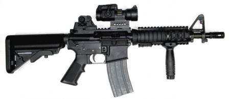 Colt M4 carbine with Mk.18 CQBR upper receiver, fitted with Aimpoint red-dot sight and additional back-up iron sights (BUIS)
