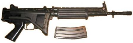 FN FNC Para, with shorter barrel, butt folded and magazine removed.