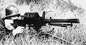 Chinese soldier fires an early version of the 35mm W87 automatic grenade launcher, fitted with drum magazine.