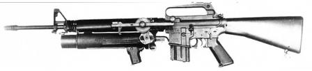 XM148 / Colt CG-4 grenade launcher on early model M16 rifle. The XM148 served as a proof of concept for more sucessful M203 grenade launcher.