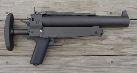 HK69 grenade launcher, with shoulder stock retracted; short-range rear sight in ready position.