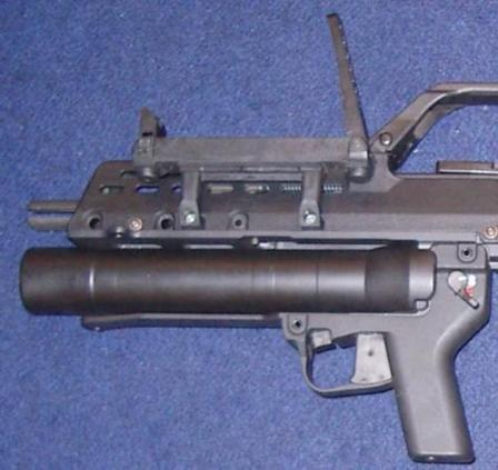 AG-36 grenade launcher mounted under the barrel of the HK G36C assault rifle.