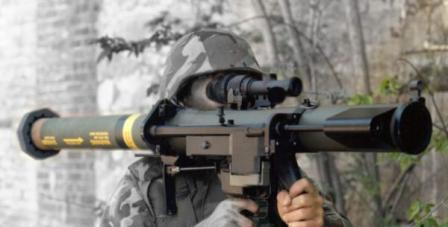 SMAW launcher in action. The barrel and mechanism of spotting rifle are clearly visible, attached to the right side of the launcher.