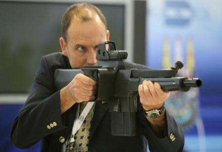 representative of DENEL Corp demonstrates PAW-20 weapon.
