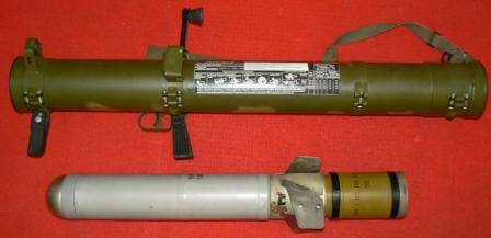 RPO-A rocket-propelled flame-thrower, in ready to fire configuration, with FAE rocket shown next to it.