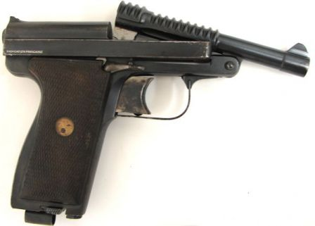 Manufrance Le Français Armee pistol, with barrel tipped up for loading. Barrel latch lever is visible above the trigger
