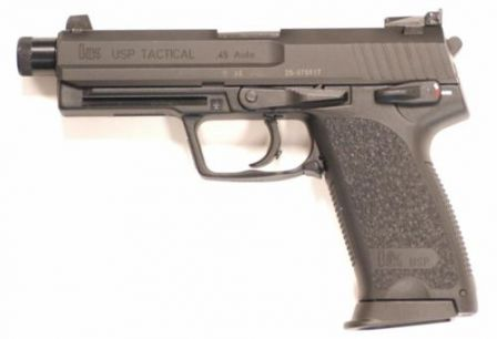HK USP .45 Tactical with extended barrel, threaded for sound suppressor (threads are covered by protector).