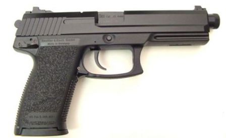 Mk.23 mod.0 pistol, right side. Note the extended barrel with screw-on thread protector on the muzzle.