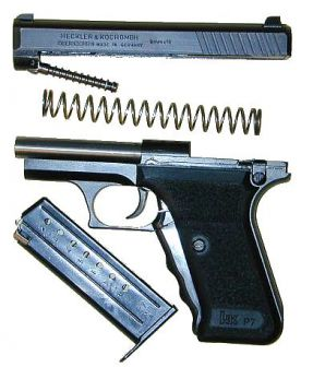 Heckler-Koch P7 PSP pistol partially disassembled; the slide retarding piston is clearly seen under the slide.