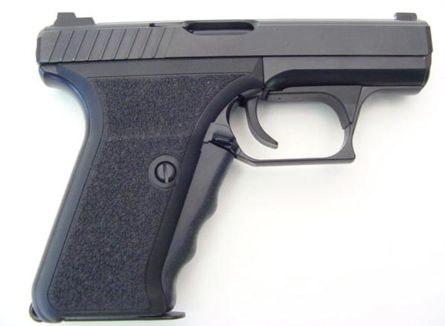 P7M8 pistol. Note magazine release lever in the base of the enlarged triggerguard, as well as heat shield above the trigger.