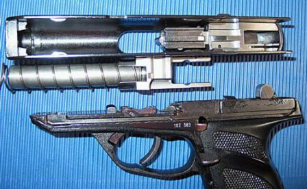 HK P9S partially disassembled. clearly seen are the barrel with its extension and cuts for rollers; and a separate two-part breechblock, inserted into the thin-walled slide.