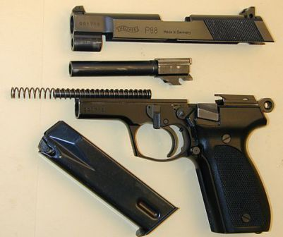 Walther P88 disassembled into major parts.