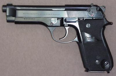 Beretta 92S - model with early style slide mounted safety and magazine release. Pachmayr grips.