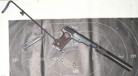 APB / 6P13 silenced pistol, with silencer and the shoulder stock attached. Target has been fired at from 25 meters distance in short bursts of 2 to 4 rounds each.