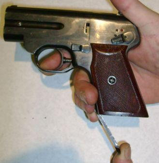 cocking the internal hammers of the S4M silent pistol