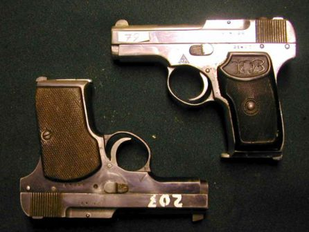 Two TK pistols (from forensic collection). Top is rare late production chromed version with plastic grips, bottom is standard blued version with checkered wooden grips.