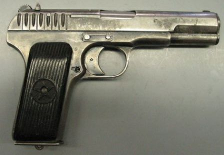 same pistol, right side view