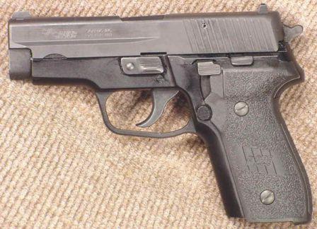 SIG-Sauer P228 pistol, left side.