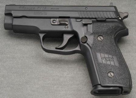 SIG-Sauer P229 pistol, left side.