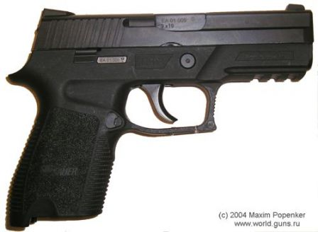 SIG-Sauer P250 DCc (compact) without magazine, right side view.
