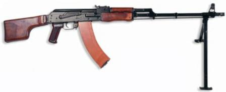 Kalashnikov RPK-74 lightmachine gun, original 1974 model with wooden furniture and red plasctic magazine.
