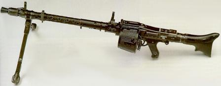 MG-34 as a light machine gun, with 50 rounds belt drum-like box.