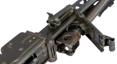 Barrel change for MG 42 - barrelis unlatched and its breech part is exposed for removal.