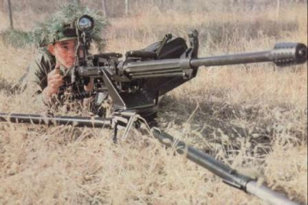 Type 77 heavy machine gun on universal tripod, in ground fire (low-profile)position.