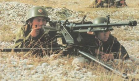 Chinese soldiers aim with the W85 heavy machine gun.