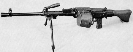 SIG MG 710-2 (MG 57-2) machine gun in light role, on bipod and with 50-round belt container attached.