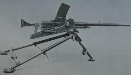Hotchkiss model 1930 heavy machine gun, magazine-fed version on infantry tripod (with AA adapter). Note rare pistol grip / shoulder stock setup, as it was tested circa 1930 in UK.