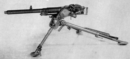 Hotchkiss model 1930 heavy machine gun, strip-fed version on infantry tripod.