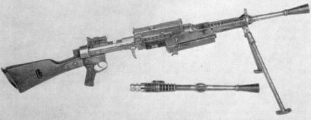 Breda M1930 light machine gun with magazine hinged forward for loading, and spare barrel shown next to gun.