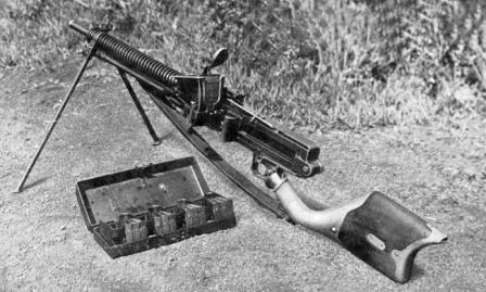 Type 11 light machine gun, loaded and ready to fire. Note that the hopper is filled with clips, and additional clips are held in special carrying case next to the gun.