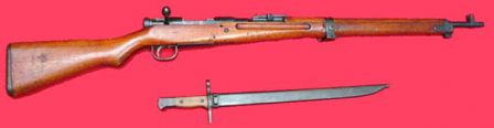 7.7mm Arisaka Type 99 rifle and bayonet in scabbard; bolt cover removed.