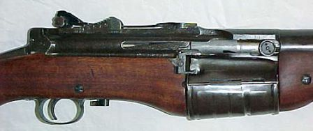 Close-up view on the receiver and magazine of M1941. Note the horizontal loading gate with stripper clip guides, located between the magazine and the bolt handle / ejection slot.