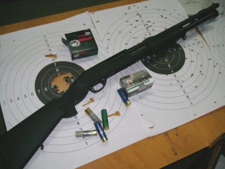 Stoeger model SP 312 shotgun with 6-round magazine; after some sighting-in, gun is capable of good accuracy when firing slugs, even with basic rudimentary sights (central hole in the left target is result of 7 shots from standing off-hand position at 25 meters; right target shows buckshot pattern at same 25 meters).