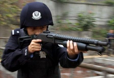 Hawk 18.4mmType 97-1Anti-riot gun (12 gauge police shotgun) in use by PAP officer.