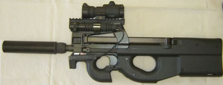 FN P90 TR (triple rail version) personal defense weapon / submachine gun, with installed accessories including optical sight on top rail, flashlight on left rail, and silencer on the barrel.