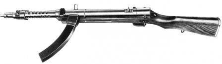 100 makineli tabanca, (1944-45 yılında yapılan) Geç savaş versiyonunu yazın.  Yerde kavisli kutu dergisi gösteren üstten görünüm.
