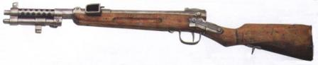 "Type 100 submachine gun, early ""paratrooper"" version with side-folding butt, bayonet adapter under the barrel and adjustable sight."