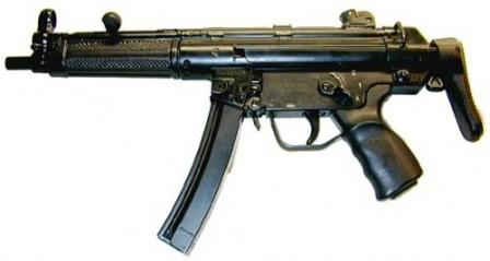 HK MP-5A3 with retractable buttstock. Earlier model with checkered handguard and a stamped steel S-E-F (in fact, S-1-A) trigger group.