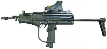 The Modern Sub Machine Carbine / MSMC submachine gun with optional Israeli-made ITL MARS red dot sight installed on the Picatinny rail.