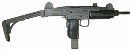 Uzi submachine gun with metallic buttstock in opened position.