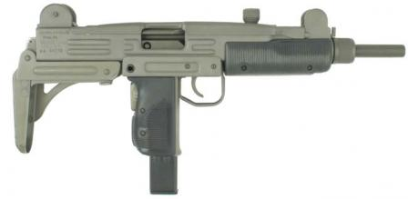 Uzi submachine gun with metallic buttstock in folded position.