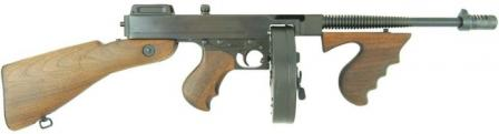 Thompson Model 1928 submachine gun with 50-round drum magazine and Cutts compensator.