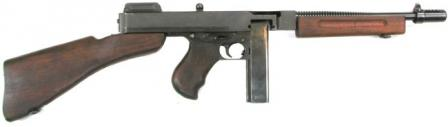 Thompson Model 1928A1 submachine gun with 20-round box magazine and Cutts compensator.