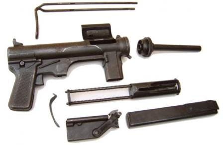 M3 submachine gun, partially disassembled. Note dual return springs and a separatecocking mechanism housing.